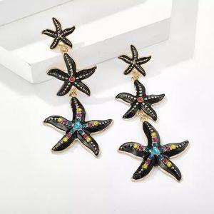 Black star fish earrings